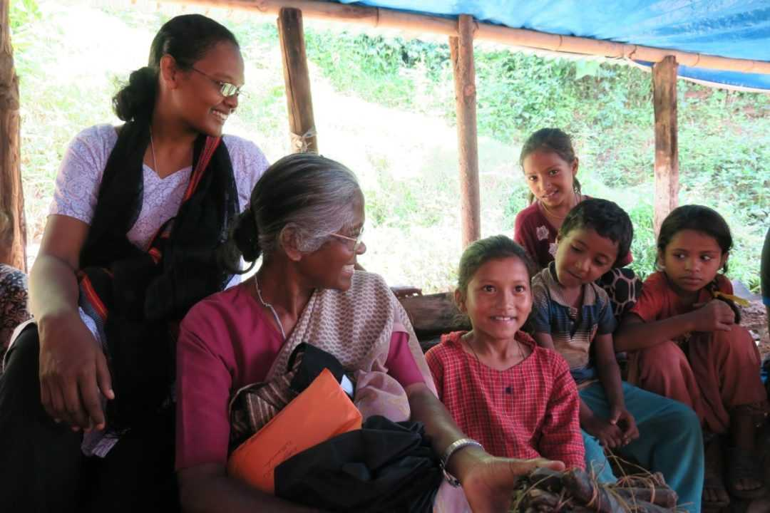 Sisters Philomina and Suchita with some of the child care center children in Rotepink Villages