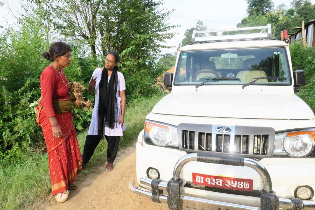 Suchita Kullu, SCN, converses with a woman on her way to Koshidekha