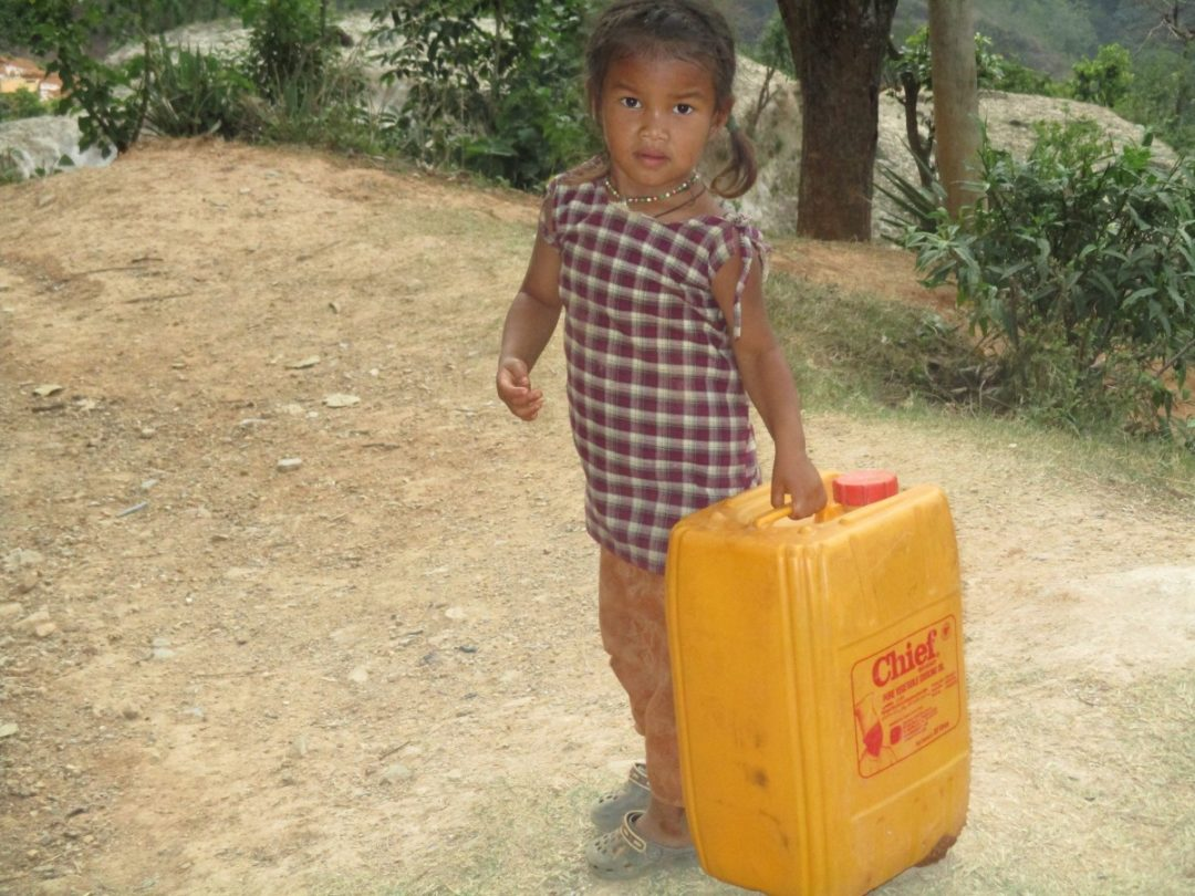 A child going to collect drinking water