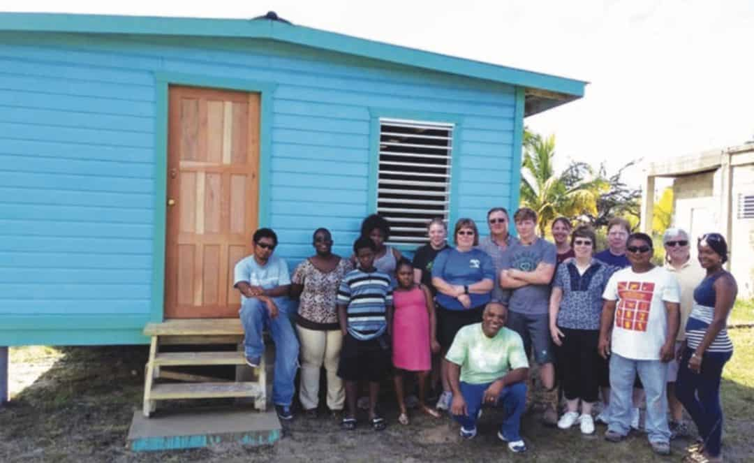 A family remembers a loved one by helping build a house in Belize
